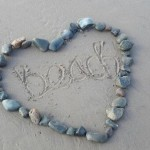 pebble heart on beach